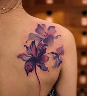 watercolor flower tattoo on shoulder