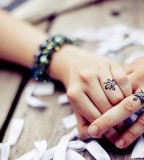 Cute Wedding Ring Tattoo on Finger