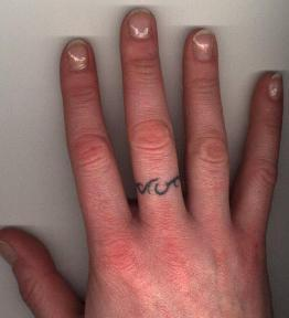 Unique Scripture Wedding Ring Themed Tattoo on Finger