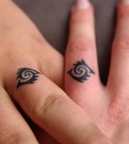 Impressive Wedding Ring Finger Tattoo Design Pic
