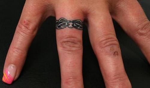 Gorgeous Wedding Ring Themed Tattoo Design on Finger