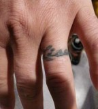 Charming Couple Name Wedding Ring Finger Tattoo