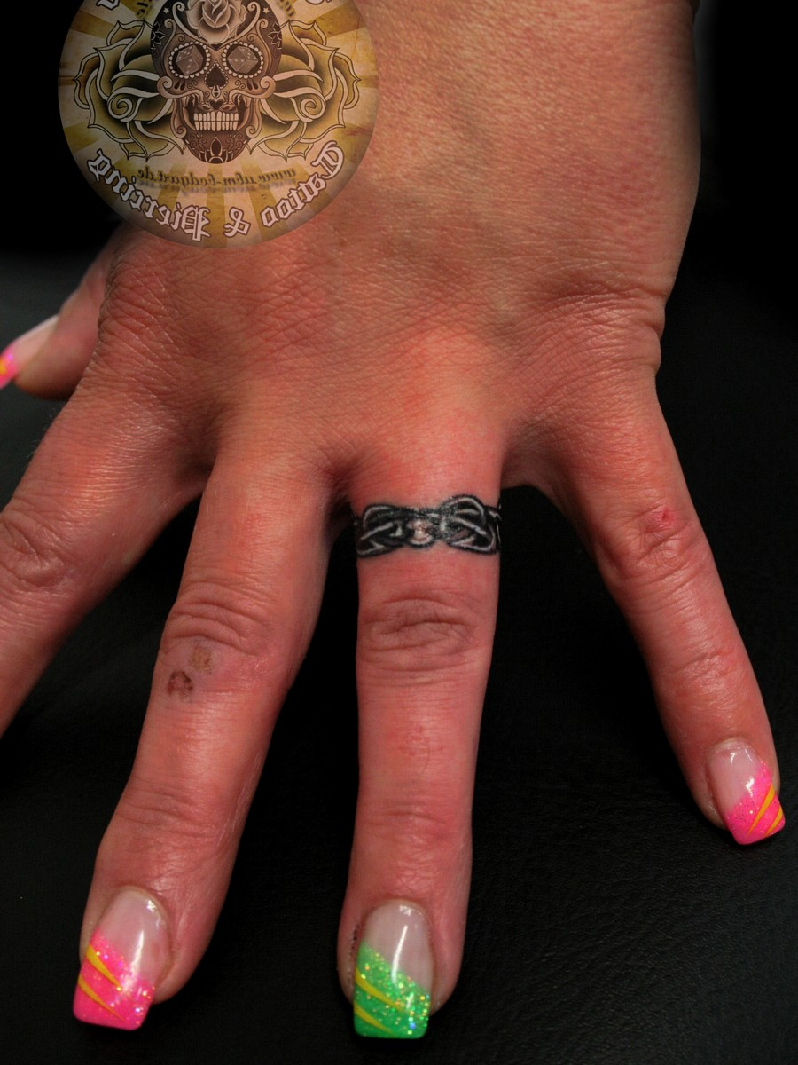 Awesome Wedding Ring Finger Tattoo Design