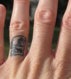 Gorgeous Wedding Ring Finger Tattoo Design