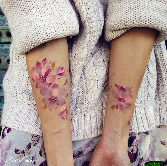white and pink watercolor flower tattoo