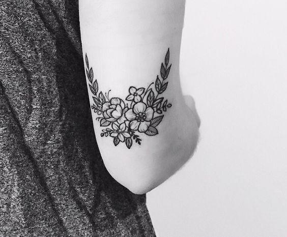 wildflower blakc and grey flower tattoo
