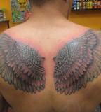 Upper-back Eagle's Wings Tattoo Design for Men