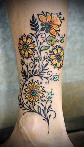 yeallowe and black flower tattoo